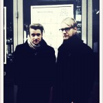 The guys in front of Beuerskafee show poster.
